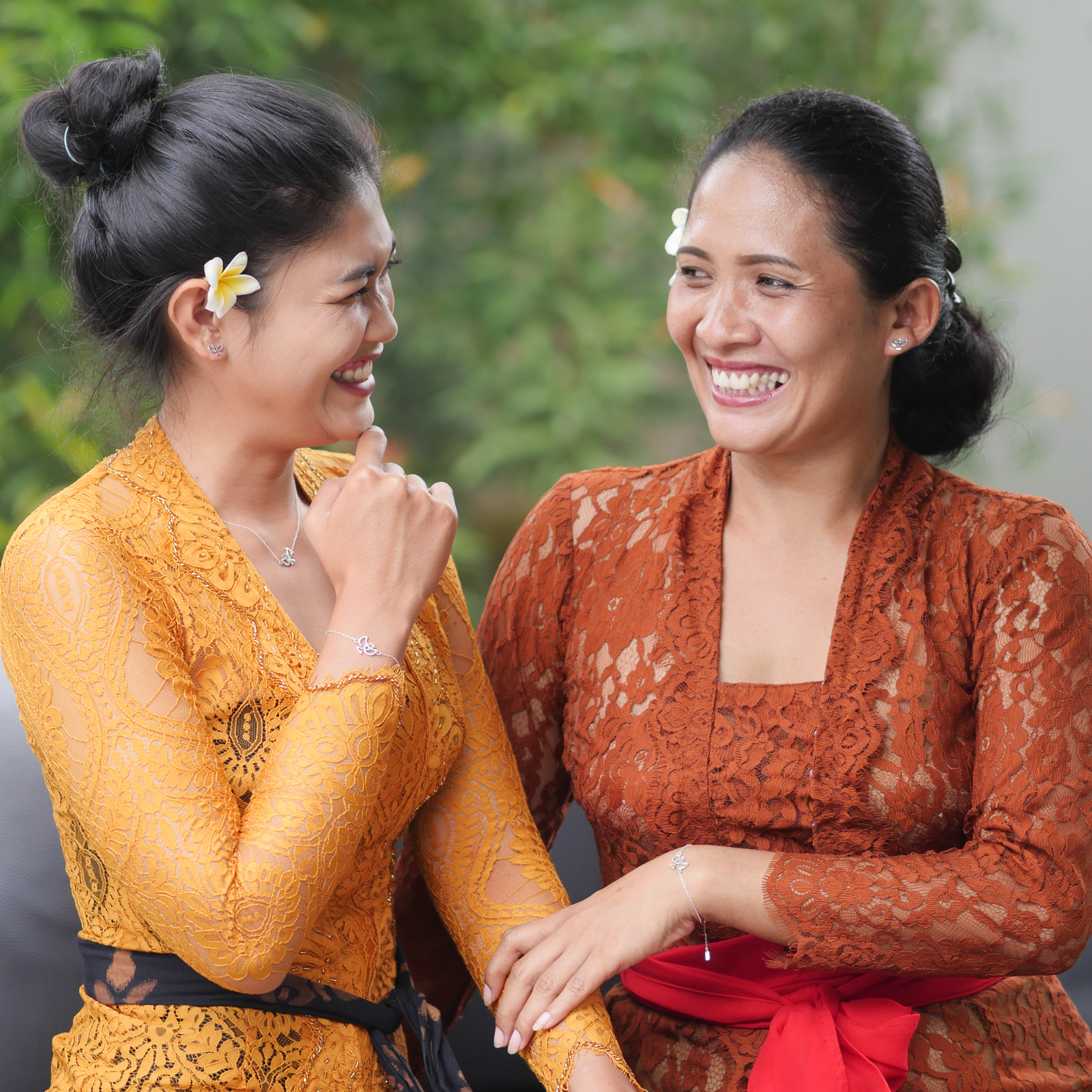 Balinese women in traditional clothing showing the Forever Label.